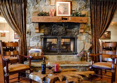 stone-house-wine-bottle-facing-fireplace-1